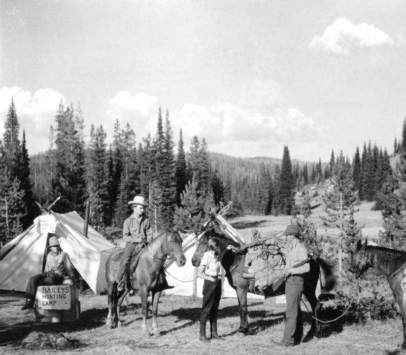 A successful elk hunter returns with the kill, Hoodoo Lake, Selway-Bitterroot Primitive Area<br />A successful elk hunter returns with the kill, Hoodoo Lake, Selway-Bitterroot Primitive Area , Swan,K. D., 1937