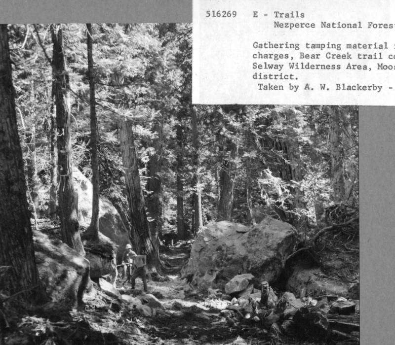 Gathering tamping material for powder charges , Bear Creek Trail Construction, Selway Wilderness Area, Moose Creek District<br />Gathering tamping material for powder charges , Bear Creek Trail Construction, Selway Wilderness Area, Moose Creek District, Blackerby, A.W., 1957-08-15