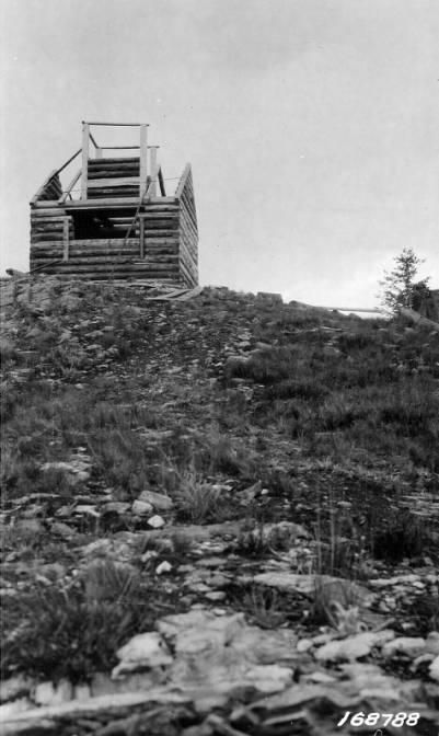 Lookout cabin under construction on Nez Perce Peak<br />Lookout cabin under construction on Nez Perce Peak, Flint, Howard, 1922-08-01