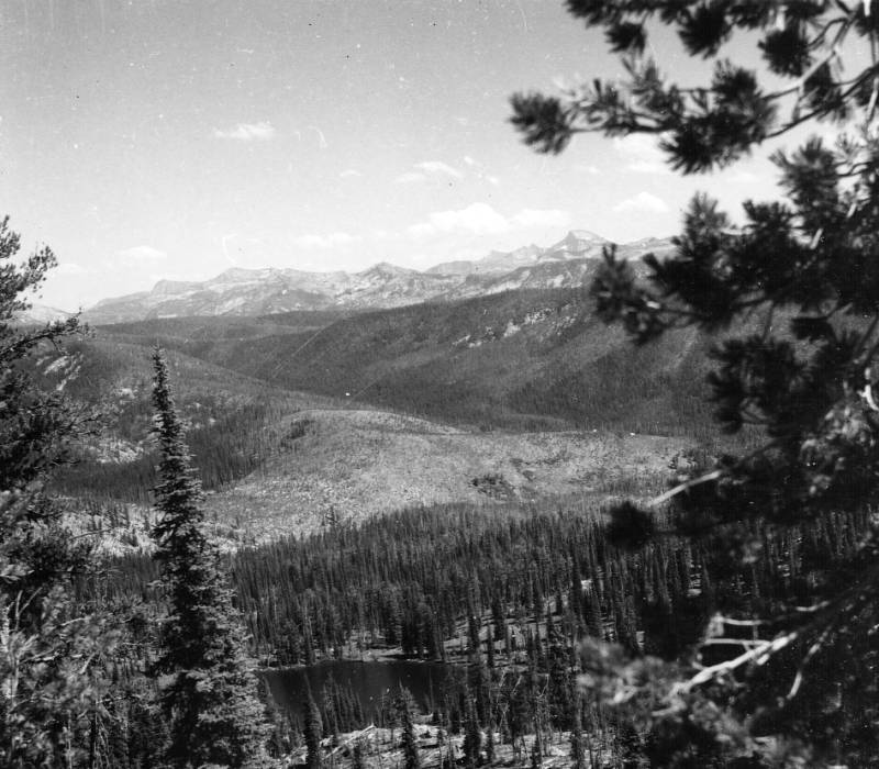 Papoose Lake, El Capitan in background, Moose Creek Ranger District<br />Papoose Lake, El Capitan in background, Moose Creek Ranger District, Blackerby, A. W., 1957