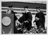 Dr. Malcolm M. Renfrew receiving an honorary Doctor of Science degree