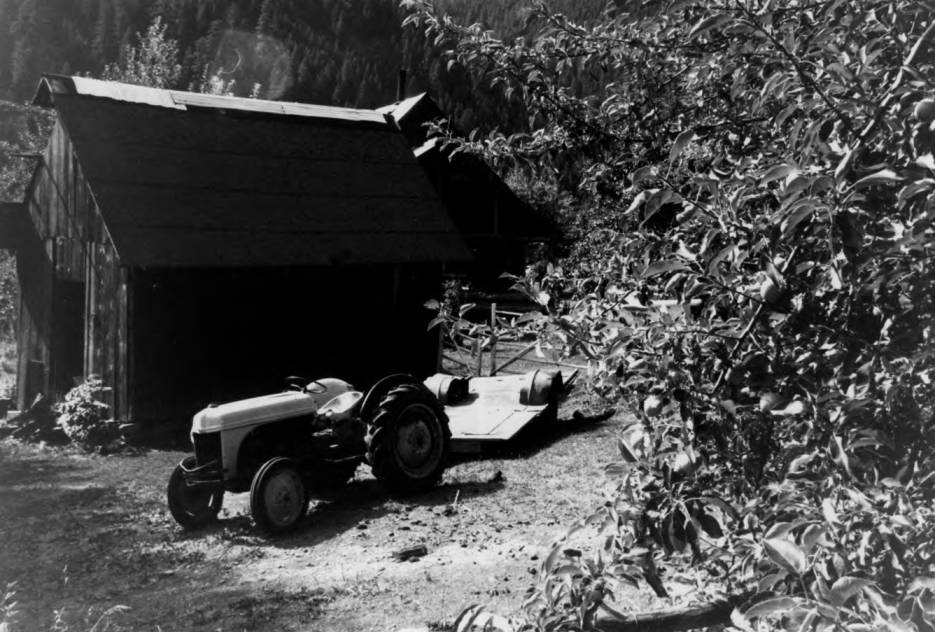 item thumbnail for Allison Ranch, tractor and shed, Red River Ranger District