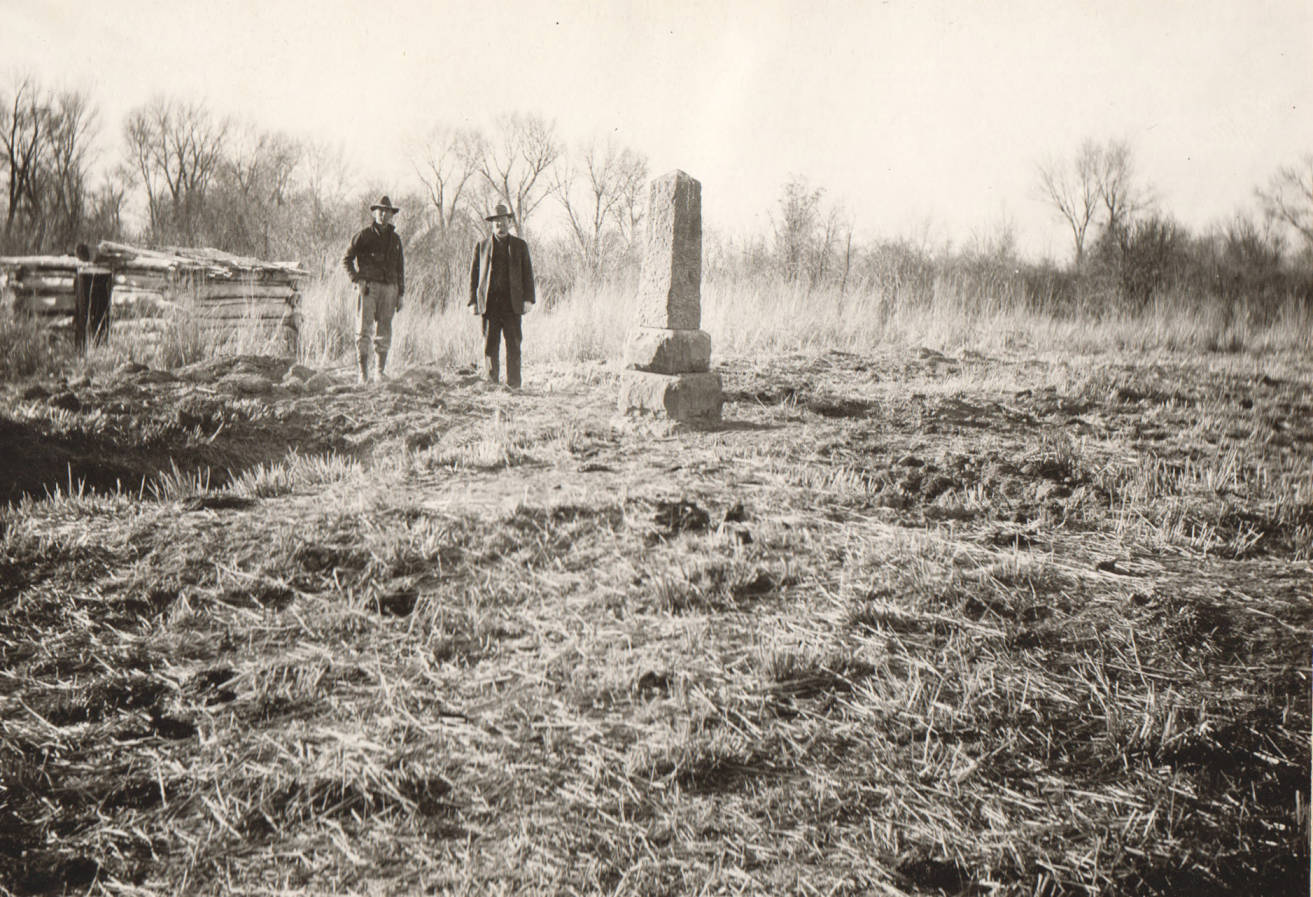 item thumbnail for Men stand near monument for Old Fort Hall site