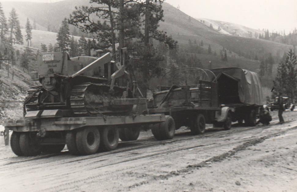 item thumbnail for Bulldozer being move on trucks