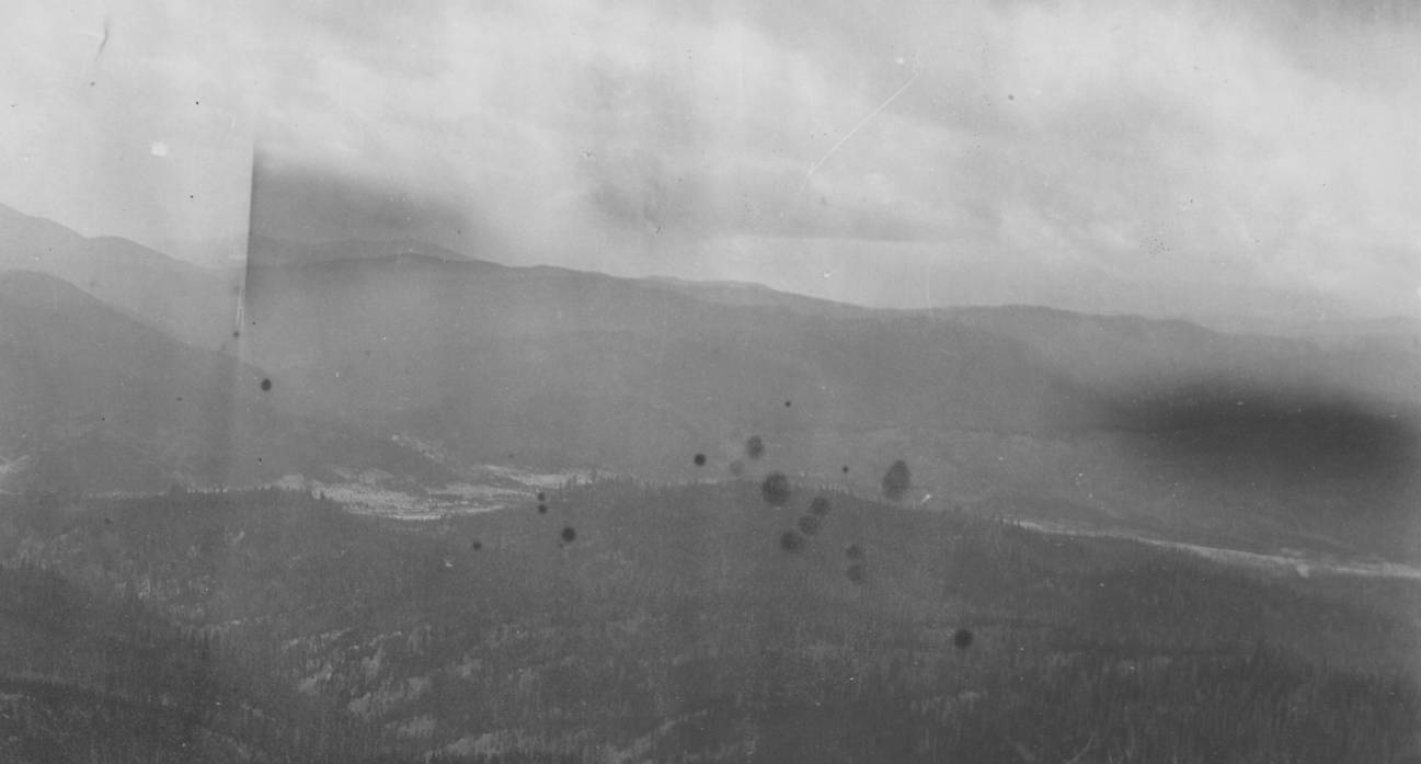 item thumbnail for Tailings and denuded slopes of placer mines, Warren Creek