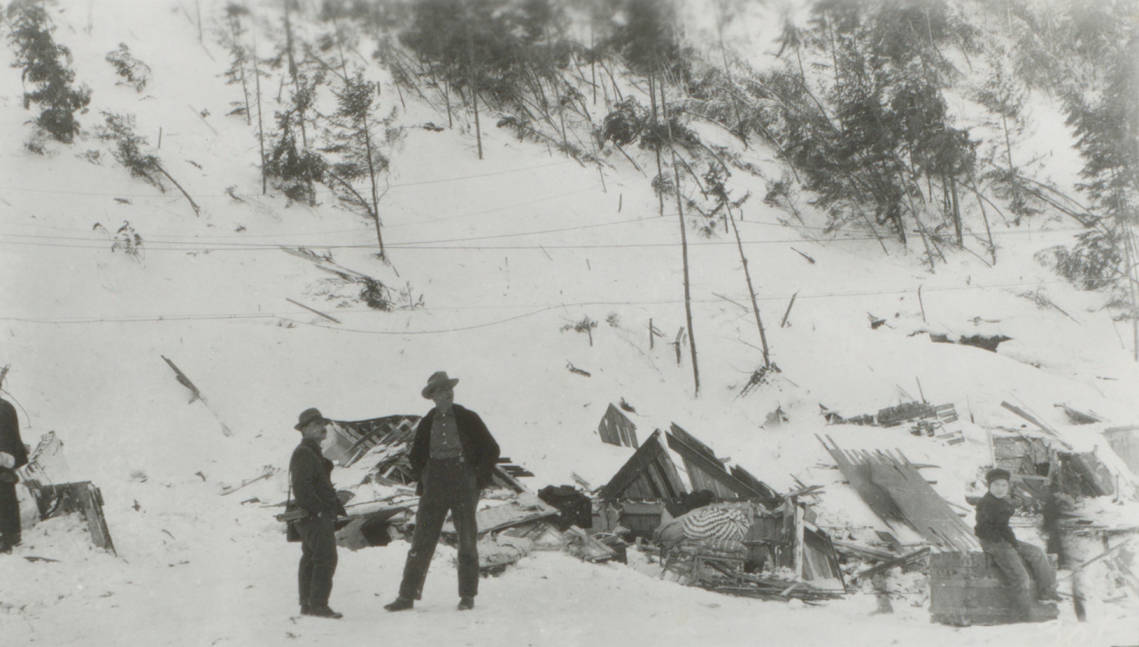 item thumbnail for Pulaski and Halm stand near avalanche destruction, Burke and Mace