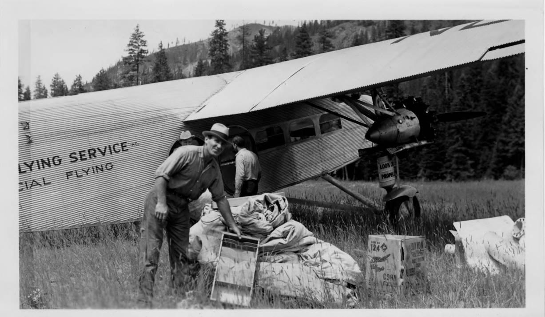item thumbnail for Unloading plane at Moose Creek Ranger Station air field
