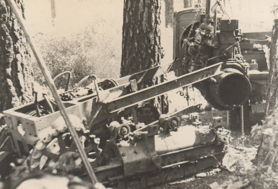 item thumbnail for Bulldozer being pulled apart