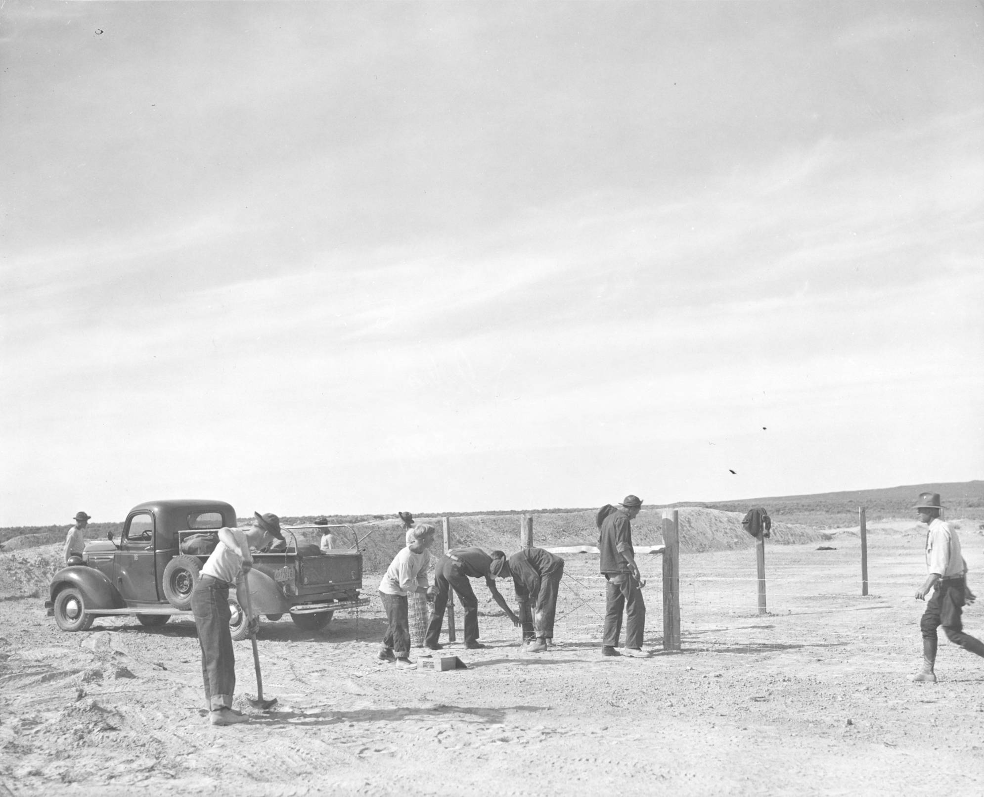 item thumbnail for CCC workers on fencing with truck