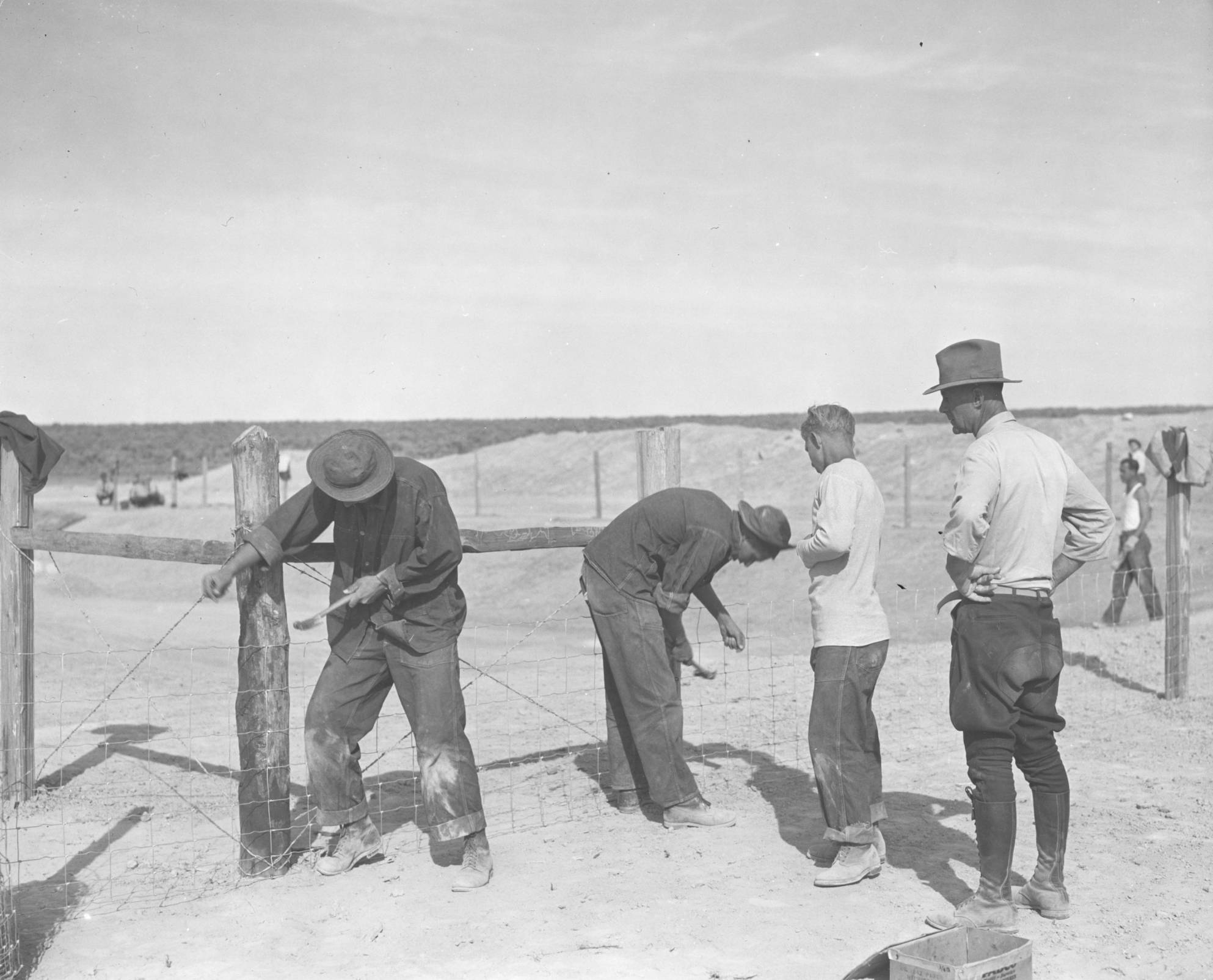item thumbnail for CCC workers nailing fencing.
