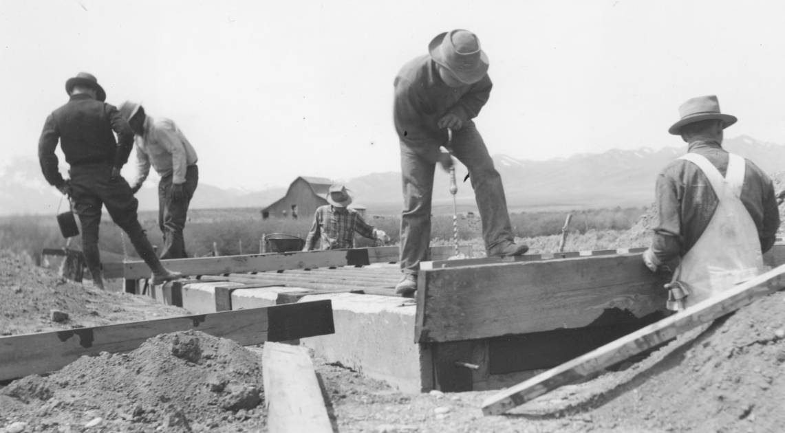 item thumbnail for Men work on construction of Arbon Trail cattle guard