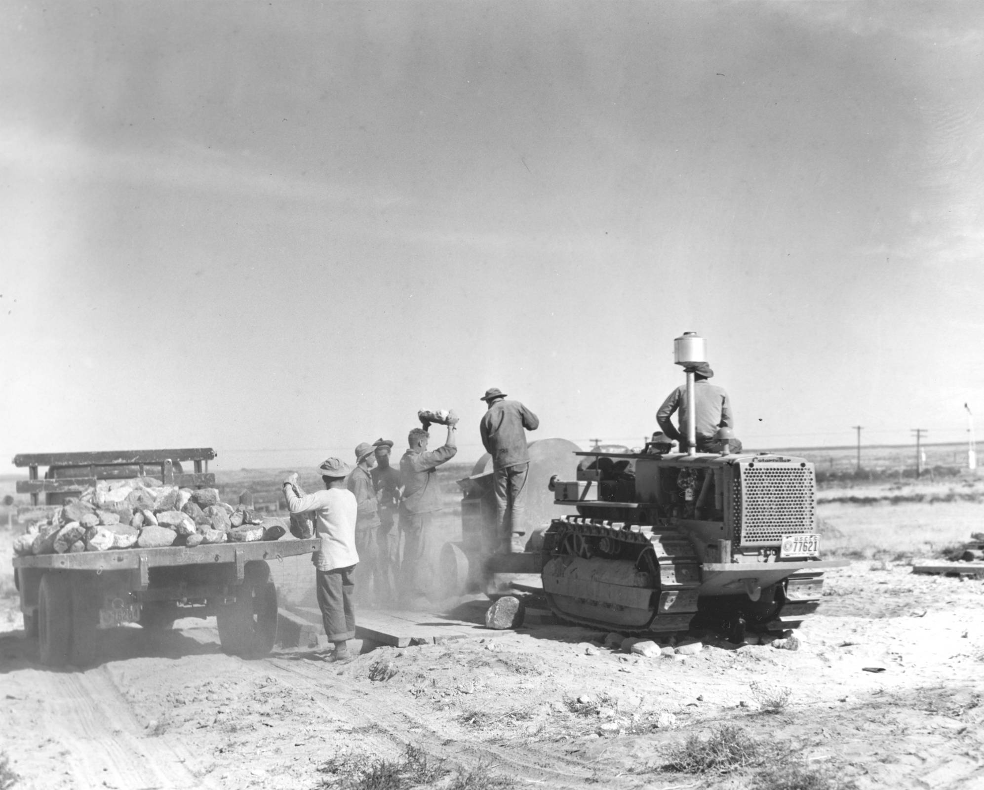 item thumbnail for CCC workers grinding and hauling away excess gravel