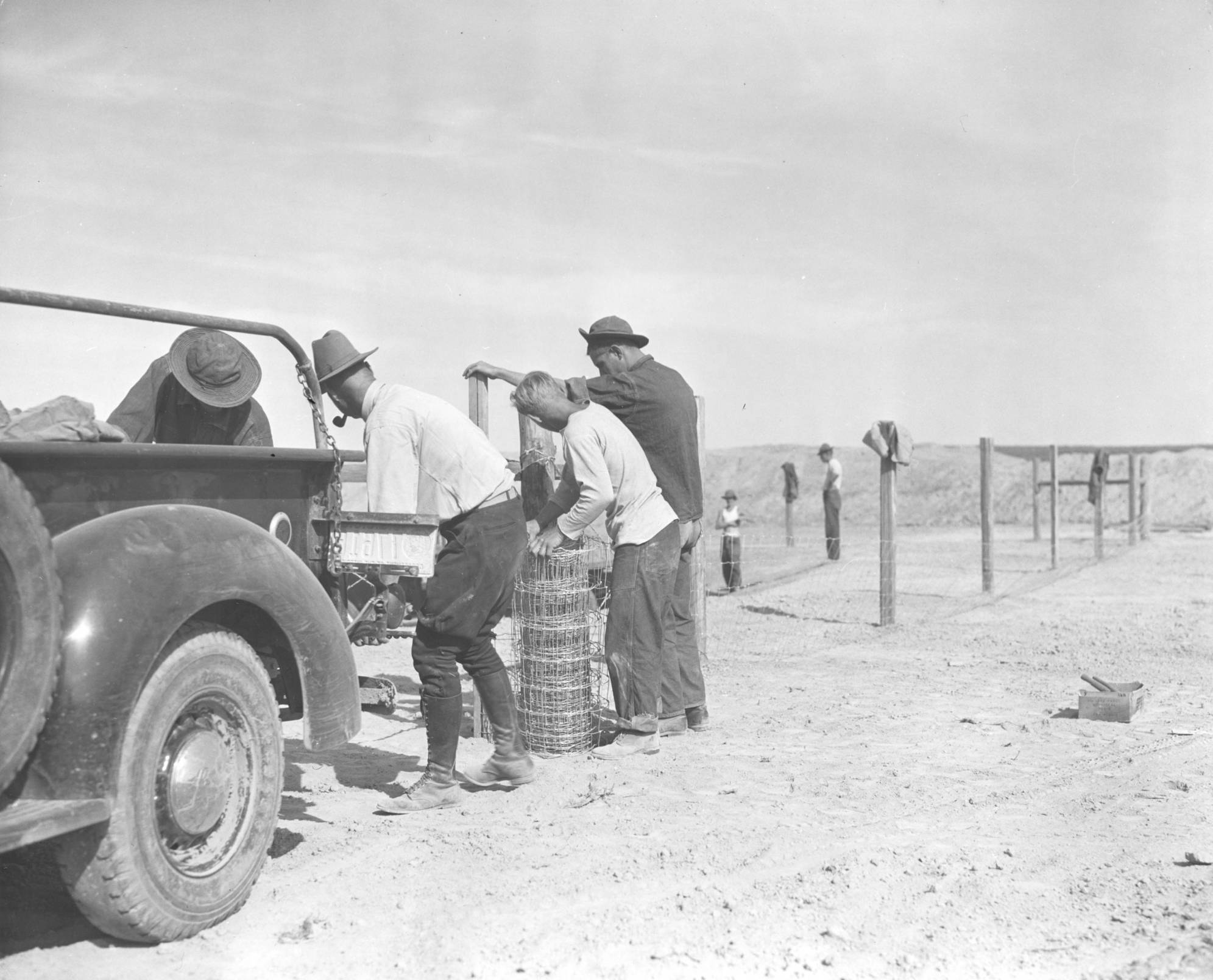 item thumbnail for CCC workers with fence roll