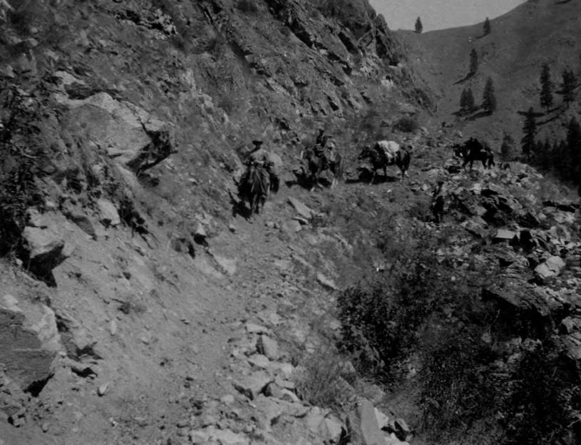 item thumbnail for Pack train and rangers on Crevice Trail on Salmon River canyon wall