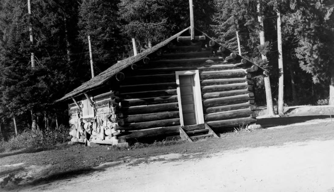 item thumbnail for Powell Ranger Station, log building with gear hanging outside