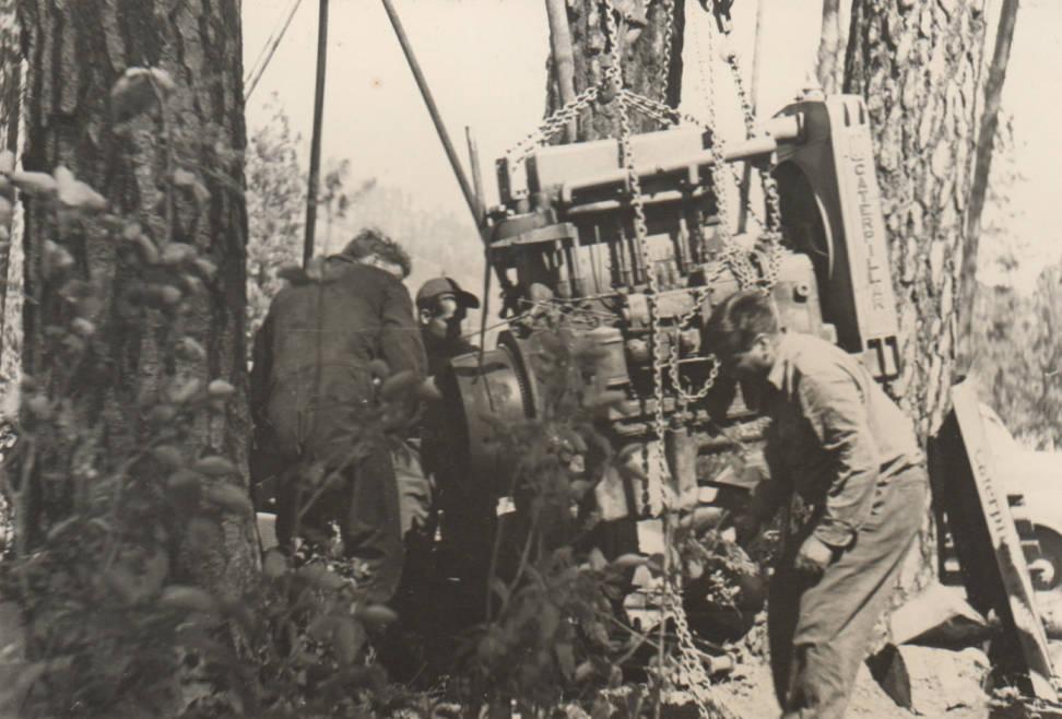 item thumbnail for Men work on repairing a bulldozer
