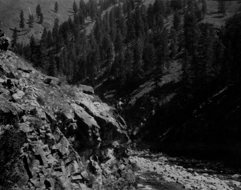 item thumbnail for Man stands on point over Salmon River on Crevice Trail