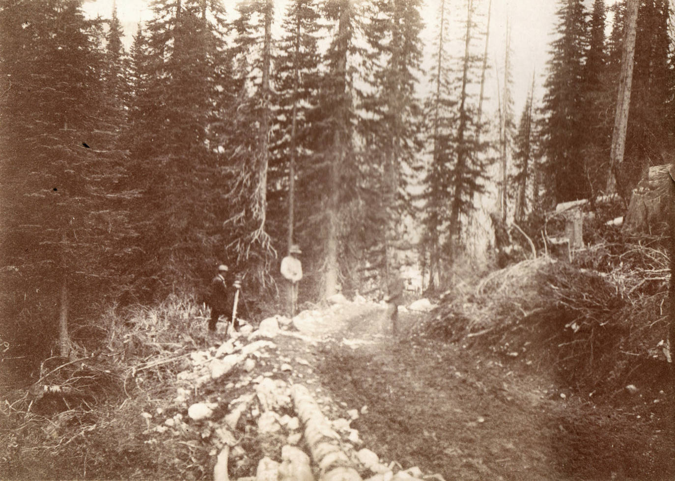 item thumbnail for Men surveying the wagon road from Lake Creek to Crooked River.