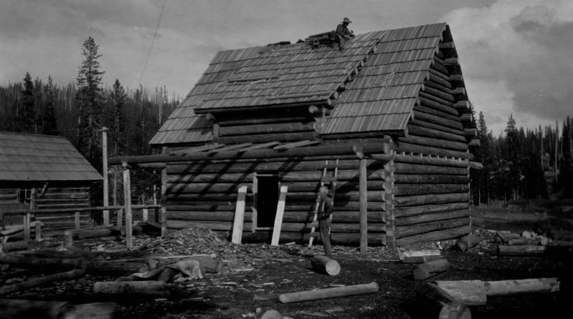 item thumbnail for Elk Summit Ranger Station, man shingling on roof