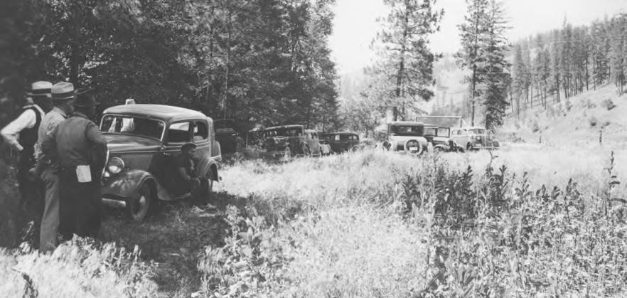 item thumbnail for Cars parked for picnic and community garden inspection