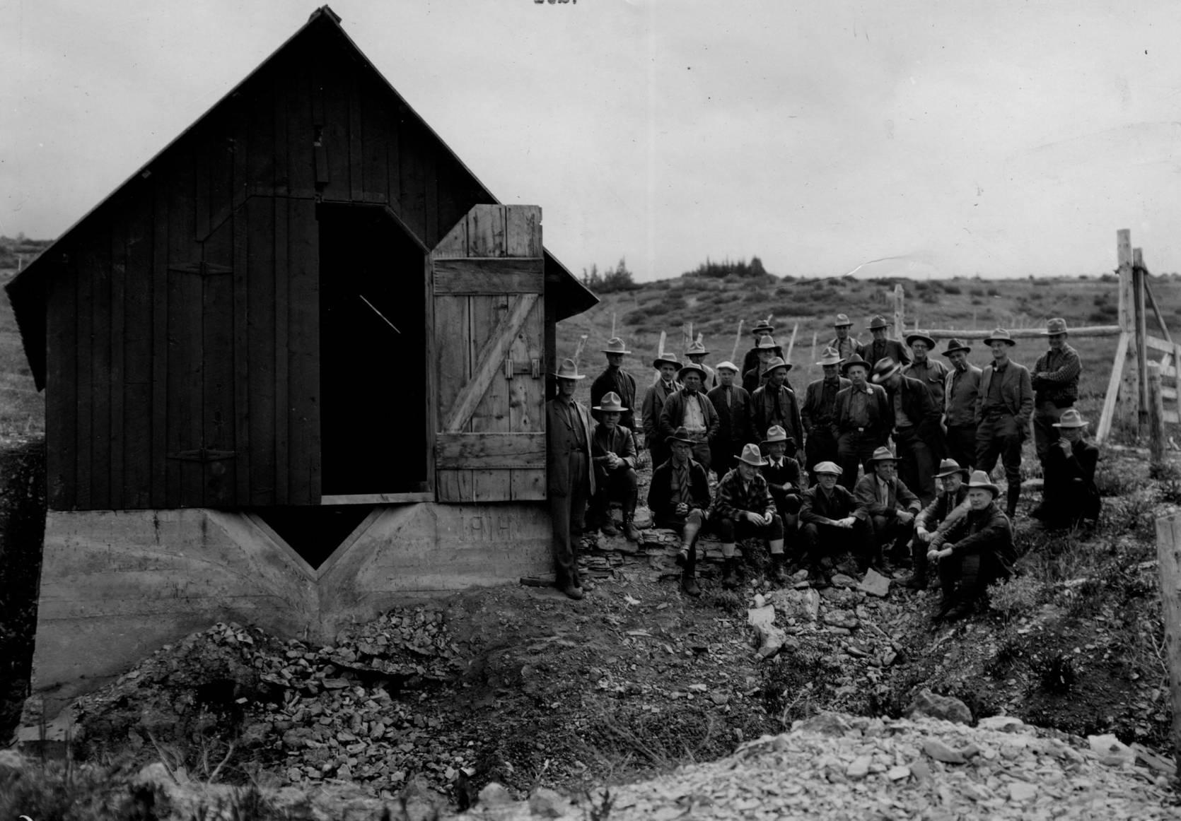item thumbnail for Supervisor's Meeting, groups of men pose near barn