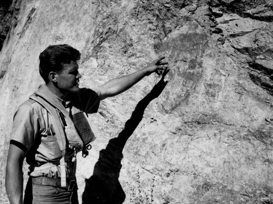 item thumbnail for Man points out pictographs near Rattle Snake Campground