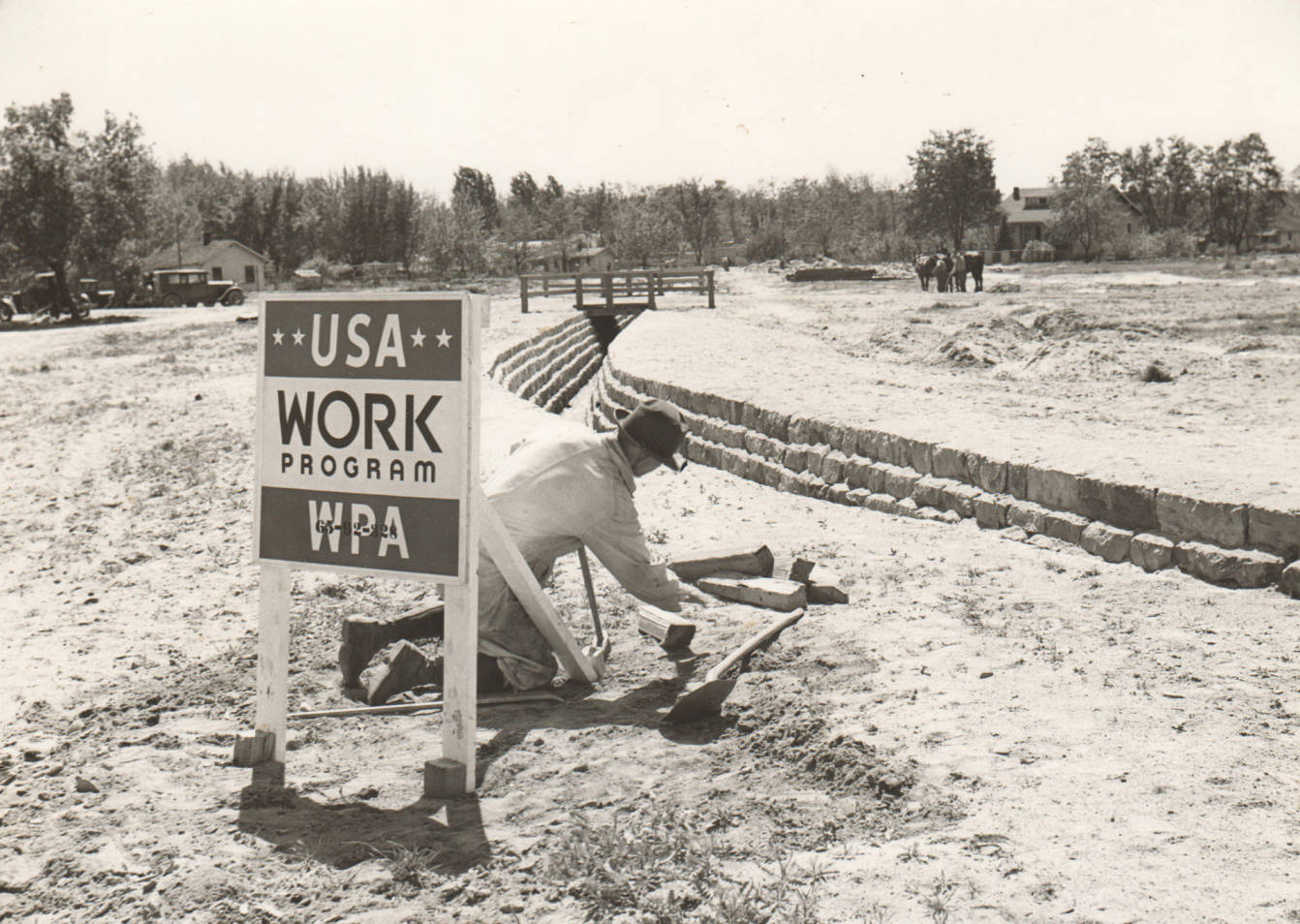 item thumbnail for Man works on Sand Creek control, WPA Project