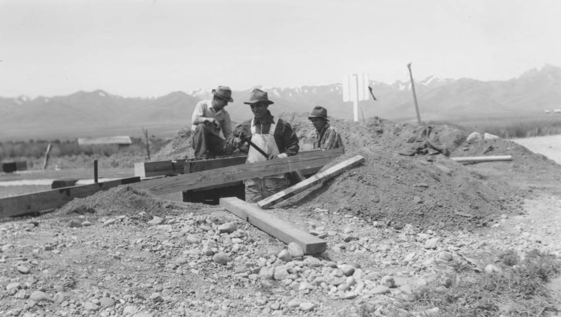 item thumbnail for Men work on construction of Arbon Trail cattle guard with treated timbers