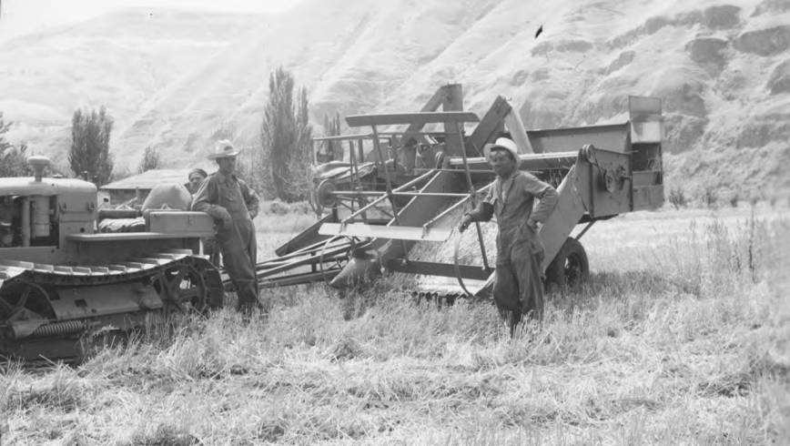 item thumbnail for Men with harvester and tractor