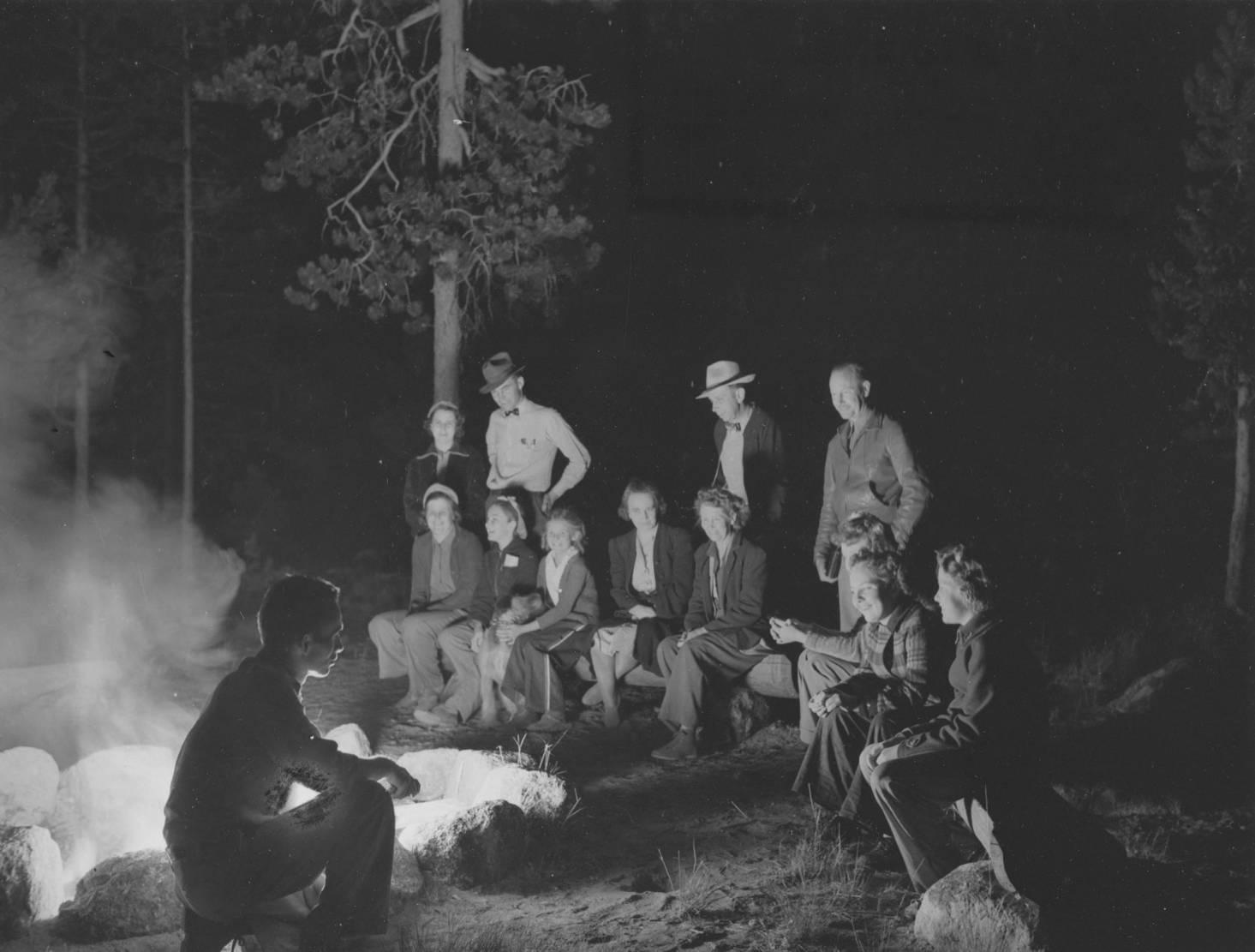 item thumbnail for Men and women around bonfire at Redfish Lake