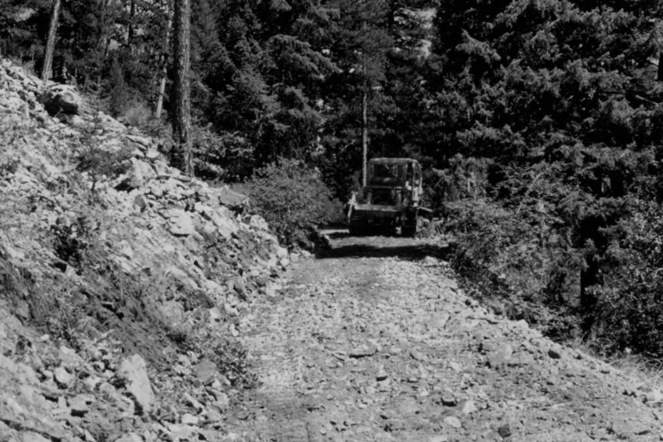item thumbnail for Big Creek Road, tractor working on Copper Camp