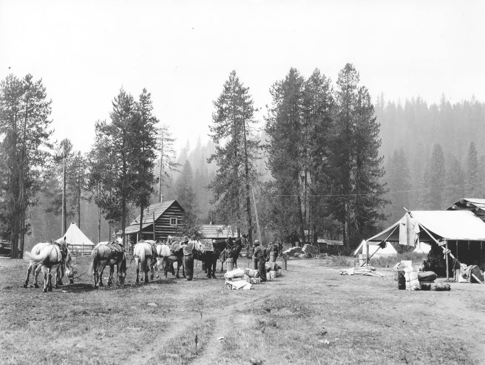 item thumbnail for Packing up pack string at Powell Ranger Station, smoke from fires in background