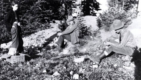 item thumbnail for L. Delroy Flores and Jim Kauffman seated on ground. June Kauffman standing. Near Dixie, Idaho.