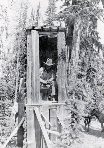 item thumbnail for Pick Ward demonstrating use of a backcountry outhouse, built for easy access in deep snow. Near Dixie, Idaho.