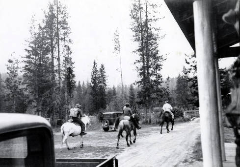 item thumbnail for Jimmy Rice, on white mule, Joe Gray, going to a fire.  Others unidentified.
