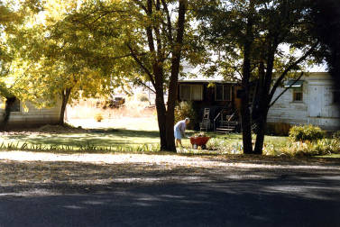 item thumbnail for View of lady doing yard work. Midvale, Idaho.