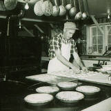 item thumbnail for Harvey Spears, longtime camp cook in kitchen.
