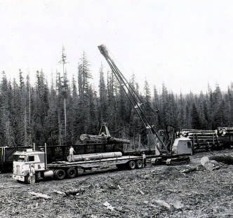 item thumbnail for Mobile crane loading logs on railcar from flatbed trailer. Camp 61.