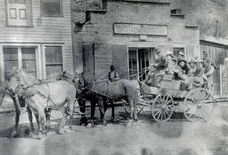 item thumbnail for Buggy full of men and women pulled by four horses. Challis, Idaho.