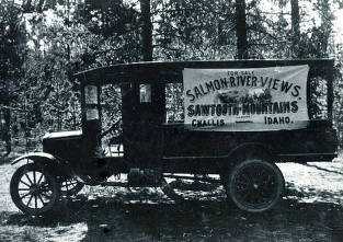 item thumbnail for Truck with sign 'For Sale. Salmon-River Views. Sawtooth Mountains. Challis, Idaho'.