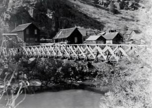 item thumbnail for Clayton, Idaho showing bridge across river and homes.