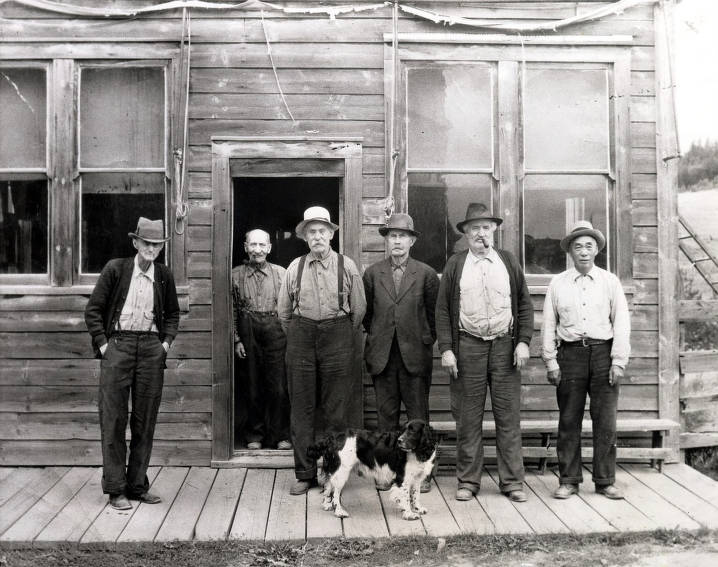 item thumbnail for L-R: Billie Allen, Little Gus Gustafson, Henry Holzman, Martin Hickman, Fred Franklin, Charlie Wong Gee standing in front of Old Blue Front Saloon. Elk City, Idaho.