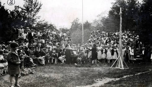 item thumbnail for May Day at Moscow Grade School. Group singing with maypole in foreground. Moscow, Idaho.