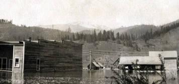 item thumbnail for Flood. Hardware store on left, Dittman house on right. Ferrel, Idaho.