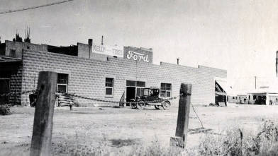 item thumbnail for Exterior view of former creamery with Ford sign and Kelly Tires sign. Gooding, Idaho.