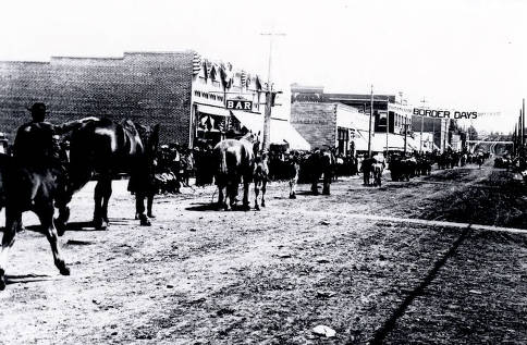 item thumbnail for Horses being led down the street at Border Days. Grangeville, Idaho.