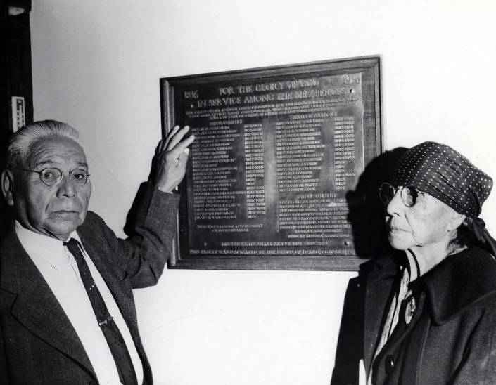 item thumbnail for Reverend Moffett and Lydia Corbett by plaque showing names of missionaries that served church from 1836-1936. Kamiah Presbyterian Church. Kamiah, Idaho.