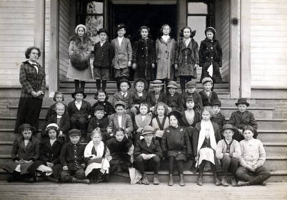 item thumbnail for 34 school children posed with their teacher, Miss Peebles, on steps of Nez Perce Public School. Nez Perce, Idaho.
