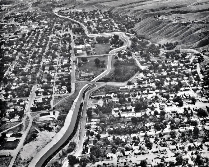 item thumbnail for Aerial view showing artist's conception of flood control project, looking upstream on Portneuf River and Marsh Creek. Pocatello, Idaho.