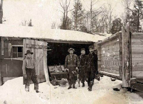 item thumbnail for Men standing by carpenters shop. Logging camp near Elk River, Idaho.